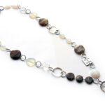 Ketting lang met ringen agaath,maansteen en glas